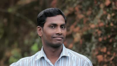 stock-footage-indian-young-man-shows-expressions-outdoors-dolly-shot-with-copyspace