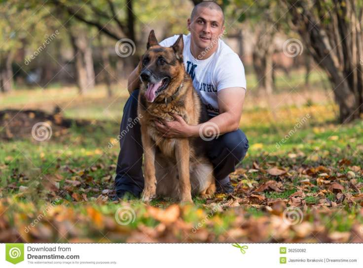 man-dog-german-shepherd-sitting-outdoors-his-pet-36250082