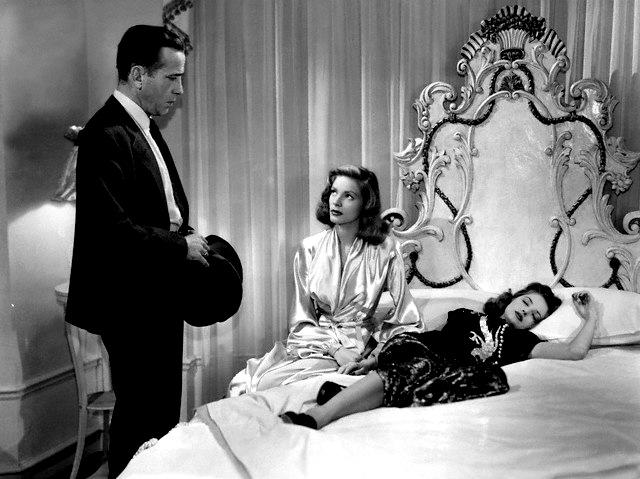 HUMPHREY BOGART as Philip Marlowe, LAUREN BACALL as Vivian Sternwood Rutledge and MARTHA VICKERS as Carmen Sternwood in À BEIRA DO ABISMO The Big Sleep 1946